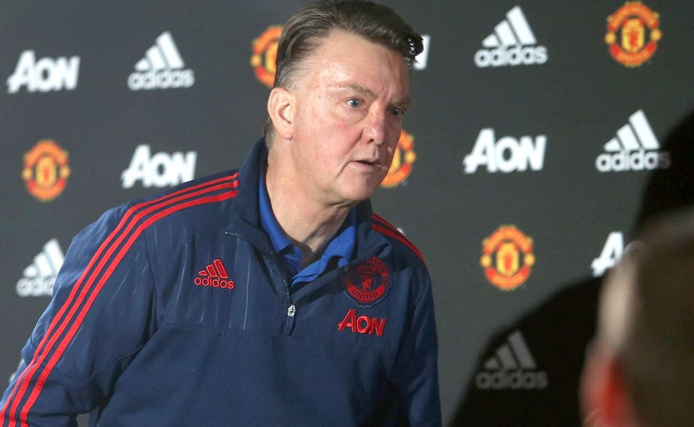 Manchester United's Louis Van Gaal Walks Out Of Press